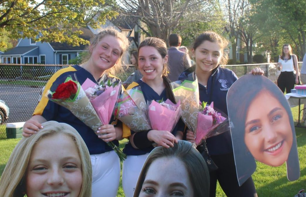 Seniors Ellie Nowakowsi, Claire Hallaway and Mia Litman pose with their cutouts.