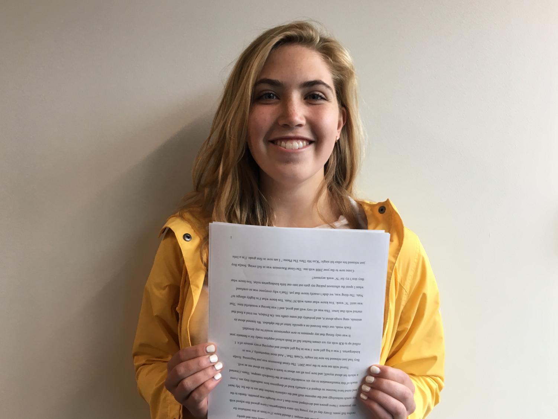Senior Sydney Therien holds the final copy of her senior speech.