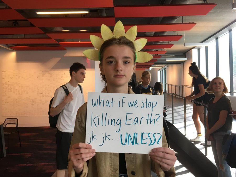 Sophomore+Val+Chafee%27s+sign+references+a+popular+trend+from+the+social+media+app+Tik+Tok.+Chafee+said+she+left+school+to+strike+because+%E2%80%9Cclimate+change+is+terrible%2C+and+not+enough+people+care.+They+post+on+Instagram%2C+and+then+they+never+do+anything.%22