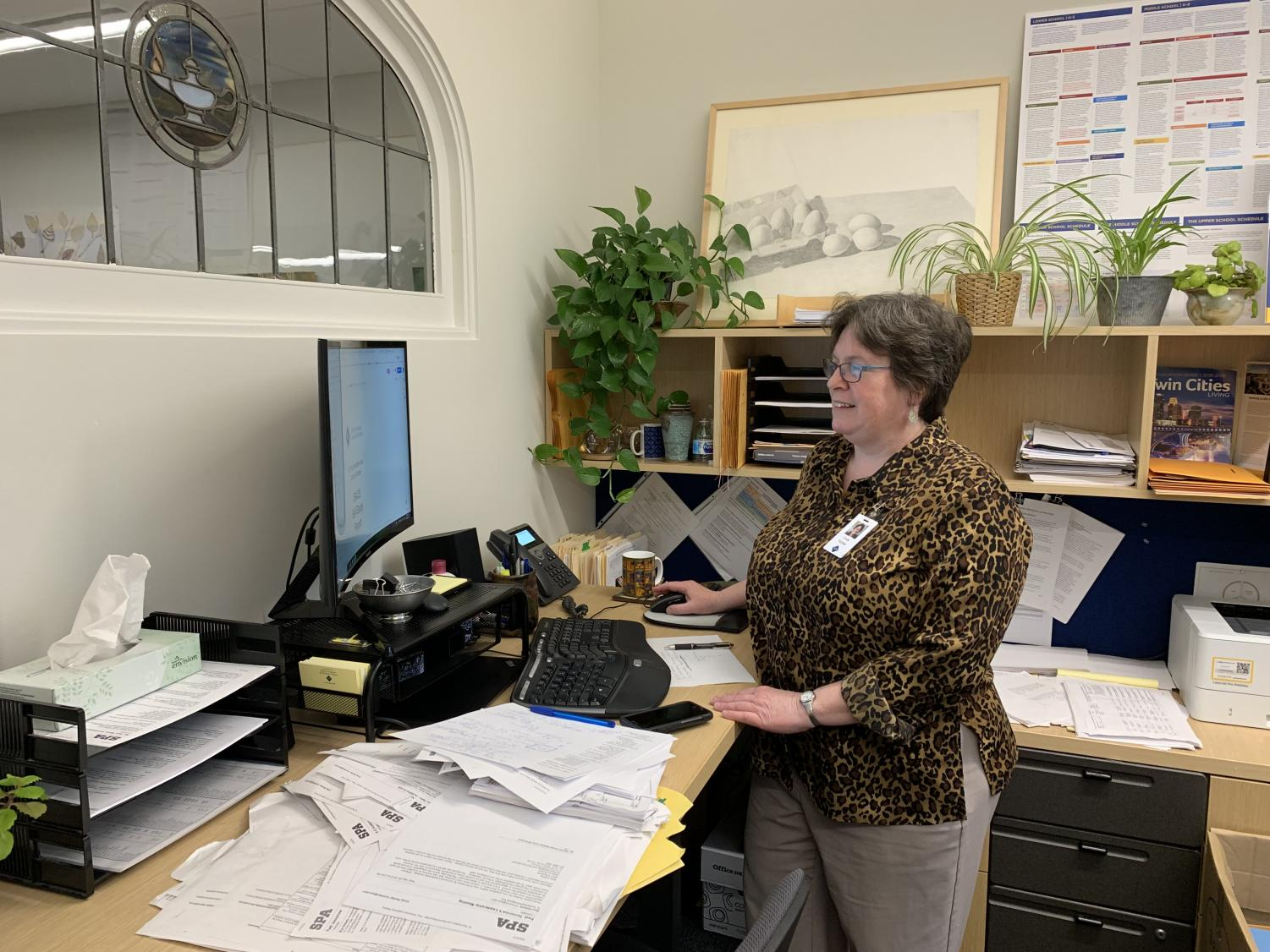 "Dr. Cindy Richter works to compile the self-study report that will be presented to the Independent Schools Association of the Central States team on Nov. 10. Dr. Richter describes her role as ""shepherding the process."" The last time an ISACS team visited SPA was in 2012."
