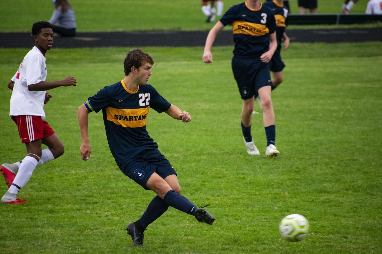 Boys soccer captain Thomas Bagnoli clearing the ball.  Photo Submitted by Galen Juliusson