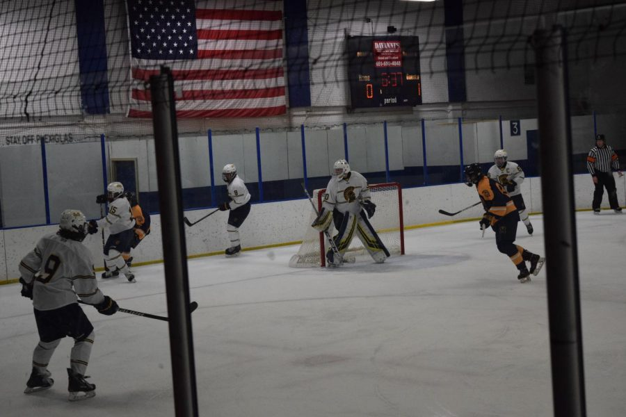 Senior+Goalie+Tom+Kuriscak+remains+alert+in+the+net+while+Junior+Will+Schavee+battles+at+Mahtomedi+player.+