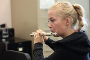 Junior and Hamburg transfer student Lotta Bublitz plays flute during sectional orchestra.