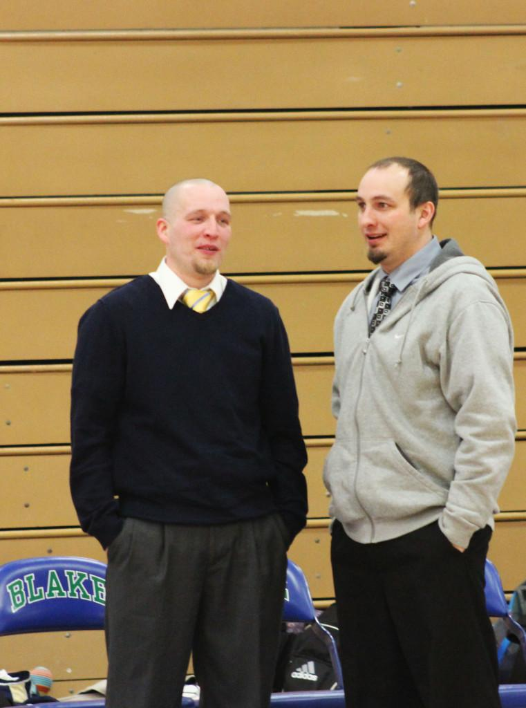 """Leigh and Rick Hemric discuss strategy before a game against the Blake School on Jan. 25.  """"I would say we have a very similar coaching style. Off the court he has strengths where I have weaknesses and vice versa,"""" Rick Hemric said."""