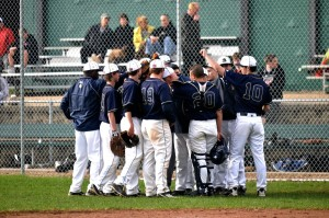 The Boys Varsity Baseball huddle together during the 2011-2012 season. This year, the snow has delayed their season, forcing them to postpone all of their games so far.