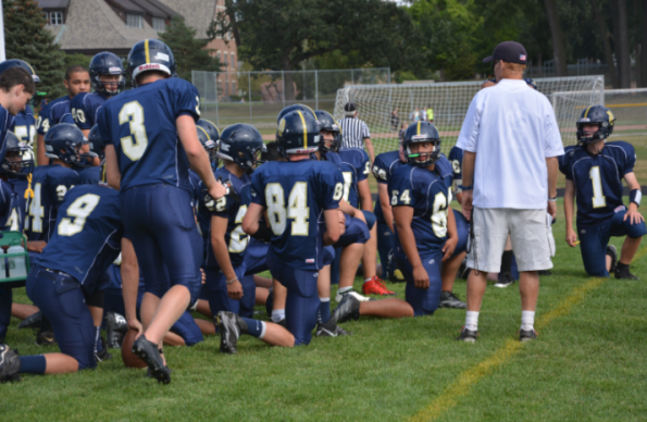 The Boys Varsity Football team prepares to play a game against St. Agnes High School on Sept. 12. The team lost 6-40.