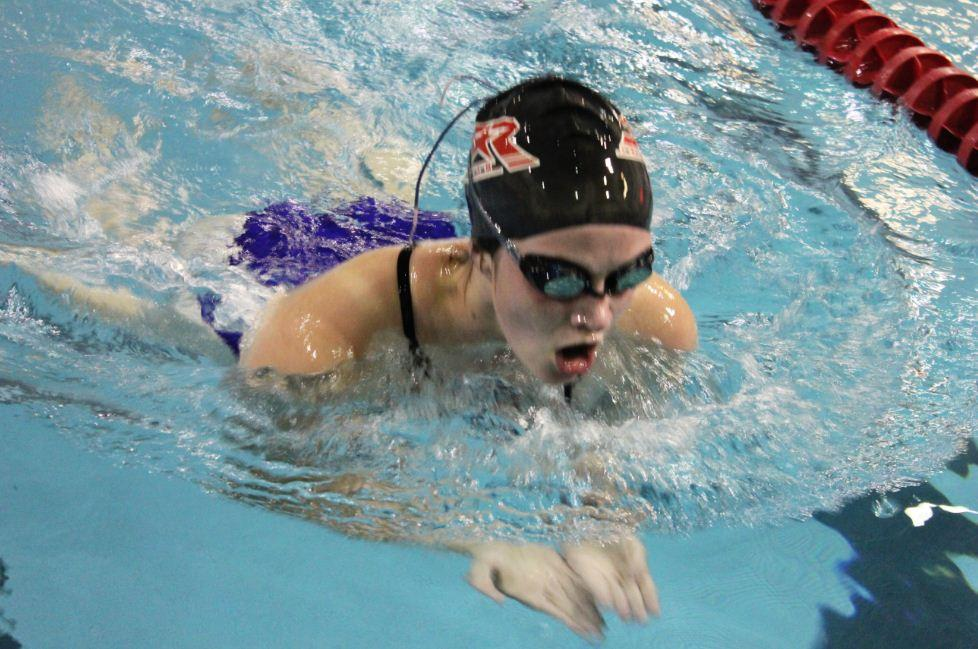 """Girls Swimming and Diving can practice up to 15 hours a week. """"People are willing to try to be better and put in the effort to be better,"""" senior captain Anna Matenaer said."""
