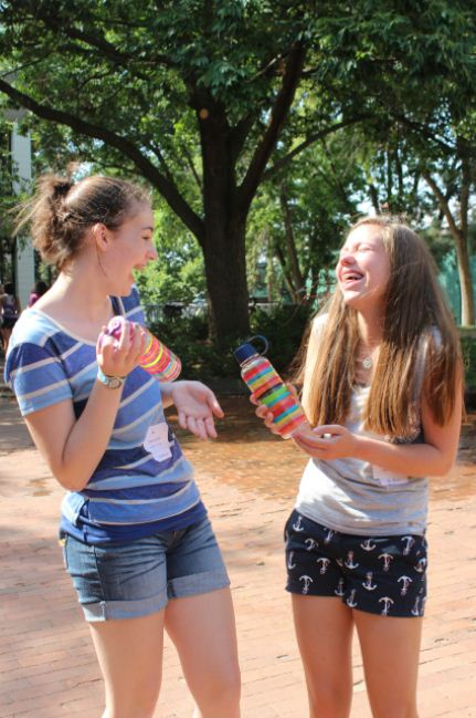 Freshmen Mary Grant and Barbara Bathke admire their new water bottles, which were given out during freshman orientation.