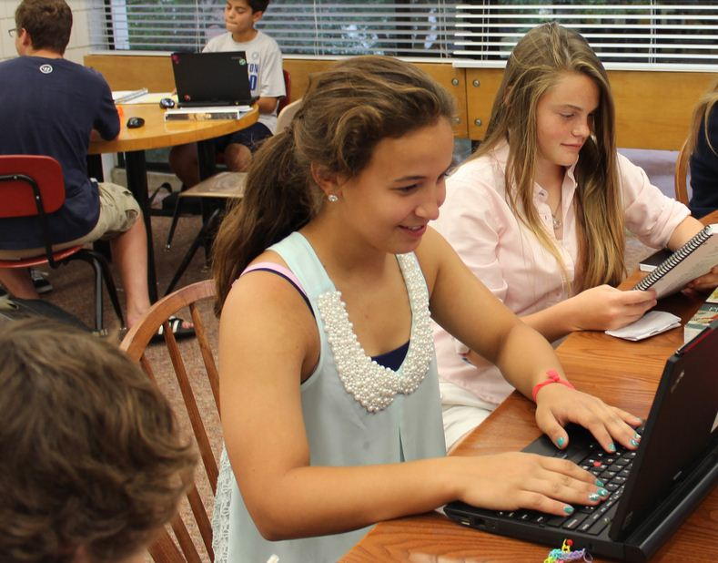 """From left to right, freshmen Maria Perkkio and Lauren Hansen work on homework during 3rd Period study hall in the upper library. """"So far the feedback has been very positive. The proctors like the atmosphere,"""" Dean of Students Judy Cummins said."""