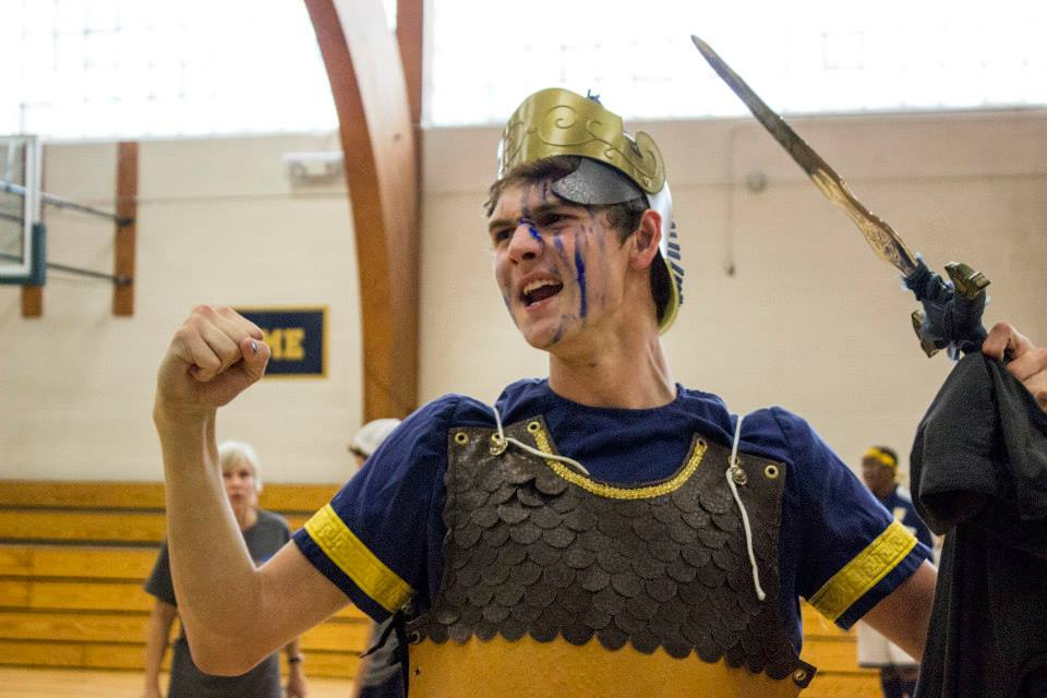 """Spartan senior Connor Allen cheers during the Homecoming Pepfest on Sept. 27. """"I am going to cheer better than any Spartan ever has or ever will,"""" he said."""