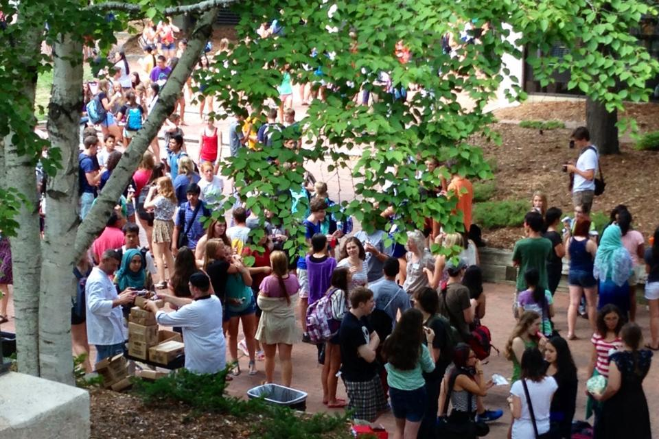 Students and teachers socialize with ice cream and popsicles in the Lilly Courtyard after the first day of school.