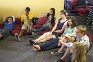 """Senior peer helpers Marcus Alburez Myers, Emun Solomon, Yusra Murad, Katherine Jones, Sydney Kuller, Charlie Southwick, and Kaia Findlay settle down at the beginning of a Peer Helpers meeting. """"If we've seen a problem in the community, we address it and talk about how we could help...,"""" Kuller said."""