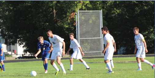 """From left: Junior Sam Suzuki, freshman Drew O'Hern, junior Jordan Moradian and junior Tyler Seplak look for an open kick in their game against Academy of Holy Angels on Sept.10. """"Our goal is to really work hard playing together as a team,"""" junior captain Tyler Seplak said."""