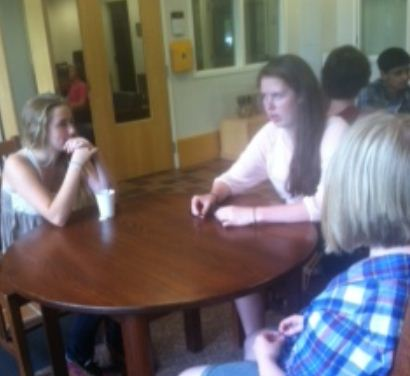 """From left to right: Freshman Hannah Stanley, senior Katherine Jones and freshman Ellie Brass talk about the different student group options. Through the student mentoring program, """" I get to meet new people, it gives me an opportunity to branch out and do stuff i wouldn't normally be able to do,"""" Jones said."""