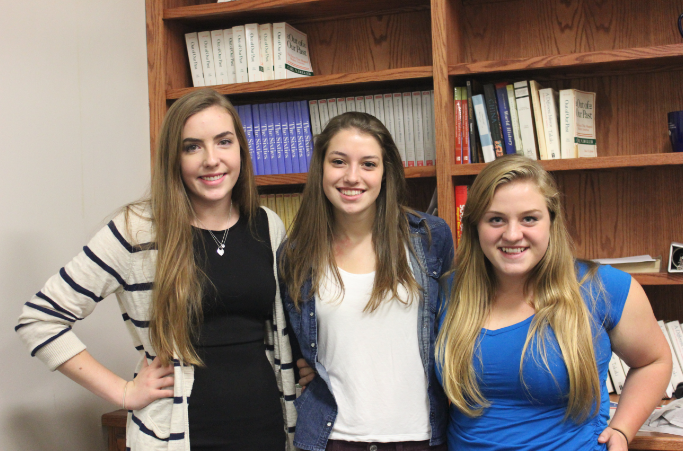 """Service Learning presidents seniors Anna Carlson and Alex Miller, along with member senior Claire Foussard, will work to plan Service Day this year. """"We're trying to get a variety of options including playing with kids, spending time in a nursing home, serving meals to the homeless, and preparing meals for a children's hospital,"""" Carlson said."""