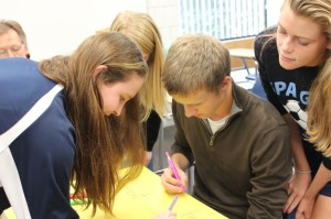 Students Against Destructive Decisions (SADD) prepare signs to encourage safety
