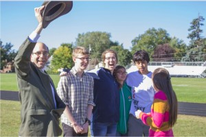 Upper School Science teacher Steve Heilig waves his hat with seniors (L to R) Michael Wlkens, Katherine Jones, Kristen Datta, Steven Go-Rosenberg, and Cristina Zarama to gain the attention of his advisory as students gathered out on the soccer fields during the fire drill.