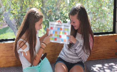 """Sophomores Rachel Hotvedt and Liz Shaheen compare their schedules for the year. """"My hope is for students and teachers to keep an open mind and keep talking about the things that work and the things that don't,"""" Upper School Principal Chris Hughes said."""