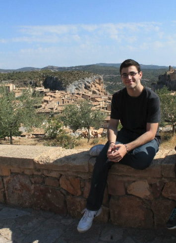 """Senior Nate Truman sits  in Alquézar, a municipality inside of  the Sierra de Guara National Park.  Alquézar is built on a limestone out crop and west of the Rio Vero. """"There is maturity, open mindedness, [and] a wider perspective that I have now that I didn't have when I left the U.S,"""" Truman said."""