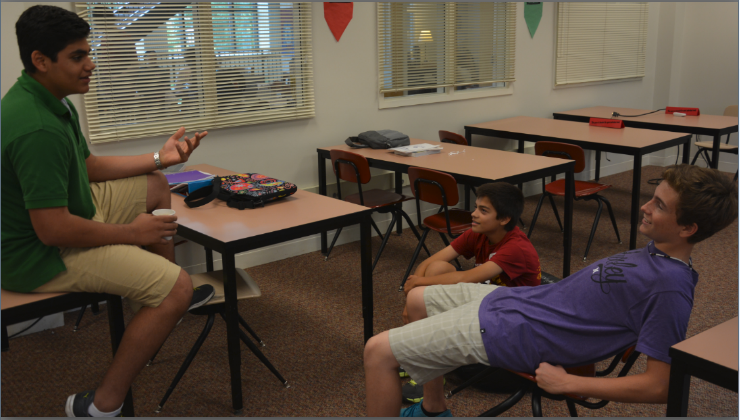 """Junior Zeeshawn Abid meets regularly with freshmen  Emilio Alvaro and Wyatt Bliss, attending extracurriculars and helping them navigate Upper School.  """"I love being [a mentor]…Freshmen this year have such a great opportunity that none of us had,"""" Abid said."""