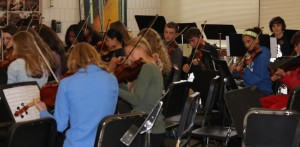 "String players rehearse for the upcoming Pops Concert. ""I like having the second half of sectionals free, so I can practice the oboe or do homework,"" junior Kevin Patterson, who plays the oboe in the winds section, said."