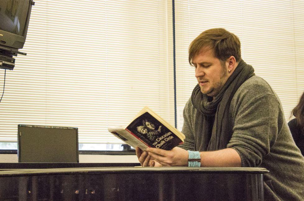 """Upper School theater director Eric Severson studies the script of The Caucasian Chalk Circle. """"It's ultimately having fun up there that makes [an actor] stand out in an audition,"""" Severson said."""