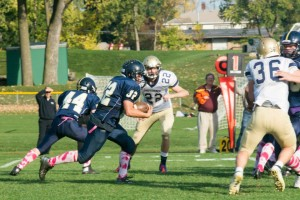 Junior running back Louie Bogolub races past a Providence Academy player.