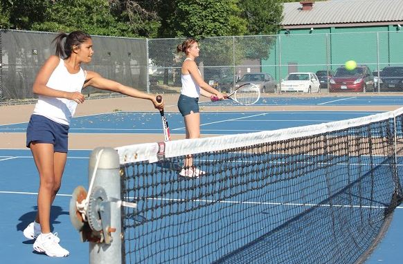 "Senior Aria Bryan and junior Eva Zaydman practice hitting volleys. ""I know we have a lot of talent on the team,"" Bryan said."
