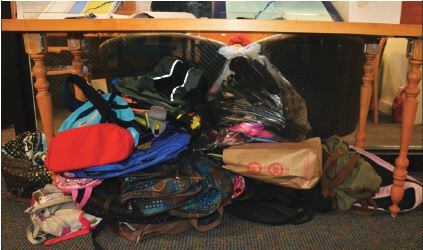 """Community Action collected 39 of the 250 backpacks needed for the Beacon project.  """"It's pretty impressive... considering our small student body,"""" junior Olivia Carry said."""