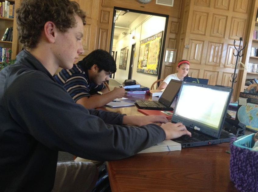 Sophomore Charlie Hooley uses Google Drive to work on a history project during tutorial.