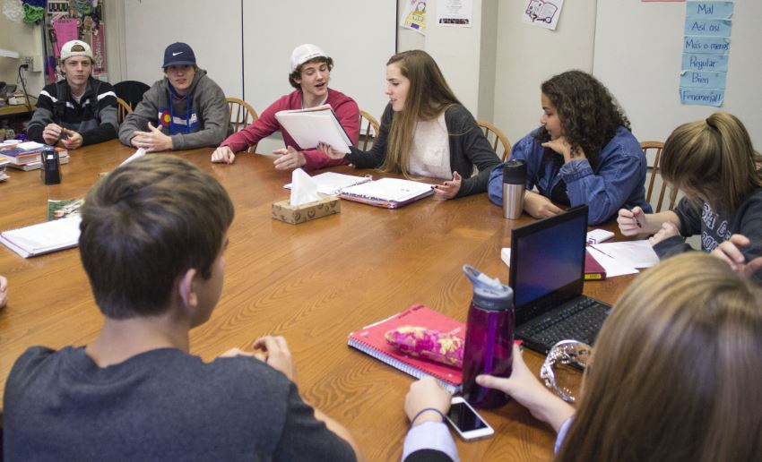 From left to right, Student Activities Committee seniors  Cal Nicholson,  Noah Parker, Mick Sullivan, Claire Foussard, Jonte Claiborne, and Chloe White sit as co-presidents Sullivan and Foussard discuss upcoming plans.