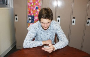 "Senior Connor Allen plays Candy Crush Saga on his phone. ""It is really fun and addicting,"