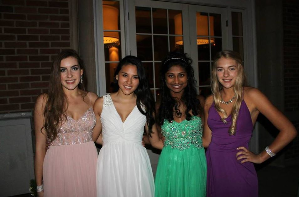 """From left: Seniors Claire Foussard, Emma Chang, Sonya Das and Alida Mitau pose for a photo prom last year, held at the Lake Calhoun Beach Club in Minneapolis. Junior Class Leadership Council has already began looking into booking this year's prom location. """"We have just been focusing on locations because we want to get that booked first,"""