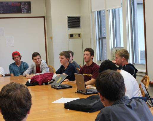 """From left: Senior Dylan White, junior Bill Naas, junior Halsey Moe, senior president Nick Cohen, and senior Nick Hoffmann engage in one of SPU's weekly discussions, """"I like being able to hear the different viewpoints of people who aren't in the majority of the rest of the school,"""" Cohen said."""