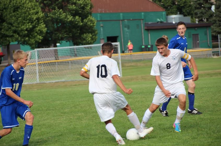 """Senior Mason Mohring and junior Tyler Seplak play during a game against Academy of Holy Angels on Sept. 10. """"It was hard at the beginning to get team unity but we're all working hard for each other. Everyone really respects each other,"""" midfielder junior Jordan Hughes said."""