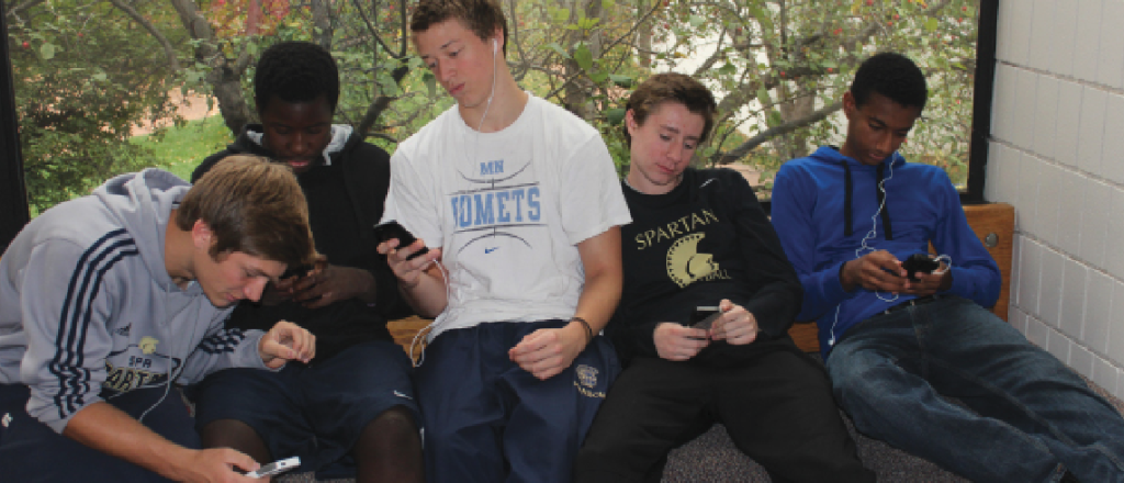"""Sophomores use phones during X period. """"We want to create a policy that accommodates the needs of the students as well as the faculty,"""" sophomore USC representitive Alena Porter said."""
