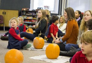 Seniors and kindergartners listen for directions before beginning. This year's pumpkins were slightly larger than previous years'.