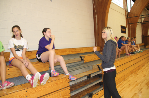 Upper School Physical Education  and seventh grade PE teacher Kaitlyn Frenchick separates her seventh grade class into teams to play handball.