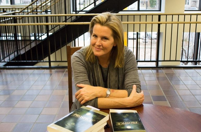 Author Karen Kelley sits at her book signing table on Nov. 21.