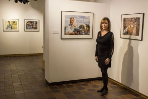 """Sylvia Horwitz stands by her pictures in the Harry M. Drake Gallery at her show's opening. """"I was deeply moved and inspired by the Madres and Abuelas and wanted to make a visual record of what I was experiencing,"""" Horwitz said."""