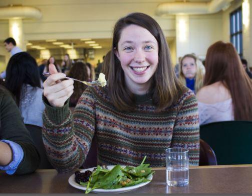 Senior Sela Patterson eats a salad at lunch.