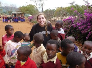 Senior Claire Foussard poses for a picture with locals from her Tanzania trip.