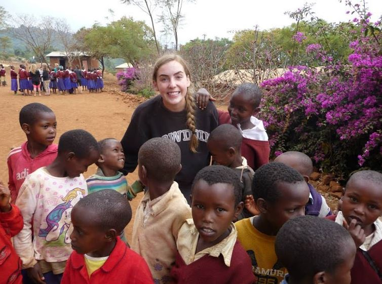 Senior+Claire+Foussard+poses+for+a+picture+with+locals+from+her+Tanzania+trip.+%22I+formed+some+great+relationships+with+both+the+people+from+the+village+I+stayed+in+and+the+other+volunteers+I+worked+with%2C%22+she+said.
