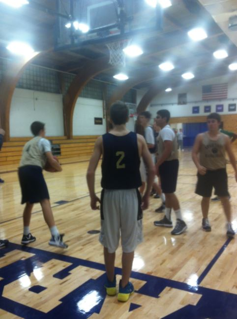 """Members of the Boys Varsity Basketball team practice after school, with senior Aidan Arnold on the left, sophomore Ryan Peacock in the middle and junior Louis Bogolub  on the right. Sophomore Dalante Peyton said, """"This year will be a different story."""""""
