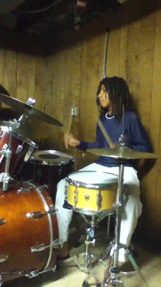 Freshman Lutalo Jones practices on his drum set.
