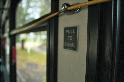 To signal the bus driver that their stop is approaching, riders must pull a yellow cord.