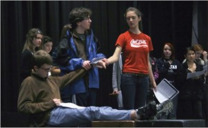 "Freshman Cole Thompson, junior Halsey Moe (sitting) and senior Charlotte Hughes rehearse a wedding scene from The Caucasion Chalk Circle. ""The cast has been absolutely phenomenal,"" Upper School theater director Eric Severson said."