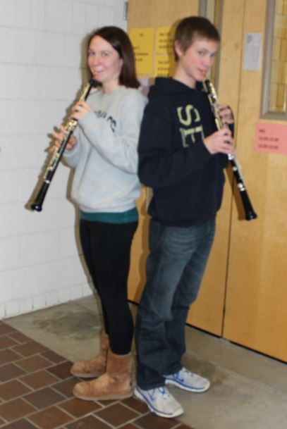 Patterson+cousins%2C+senior+Sela+Patterson+and+junior+Kevin+Patterson+pose+with+their+oboes+after+rehearsal.+When+considering+the+challenges+of+the+instrument%2C+Kevin+said%2C+%E2%80%9Cthe+hardest+thing+is+that+it+is+sometimes+a+little+difficult+to+produce+a+good+sound+that+is+in+tune.%E2%80%9D