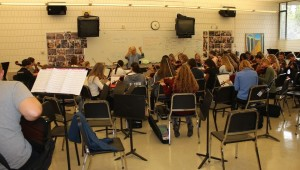 """The Academy Symphony and Honors Sinfonia practices a Star Wars medley during Thursday tutorial. """"All the pieces sound good [now]. It's going to go well,"""" sophomore Will Donaldson said"""
