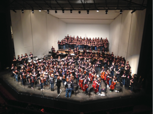 """Students stand for applause at the end of the Pops Concert on Dec. 7, 2013. """"In general, I am very happy with all of my students this year. Everyone is working hard and is doing their very best,""""  Upper School Orchestra Director Englehardt said."""